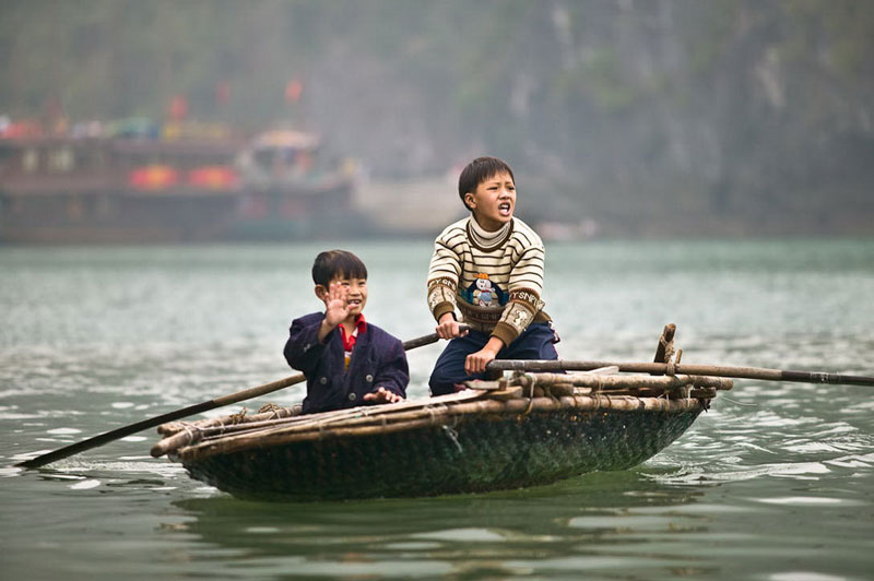 Vietnam tours 12 days row boat on halong bay.jpeg
